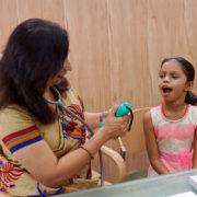 Dr Sujata Naik examines a child in homeopathy clinic