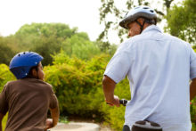 Father and son bike riding
